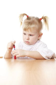 Child Playing With A Syringe Royalty Free Stock Photography