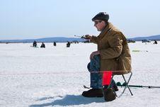 The Fisherman On Winter Fishing Stock Image