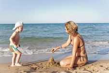 Free Mom And Son Building A Sand Castle Stock Photos - 19208593