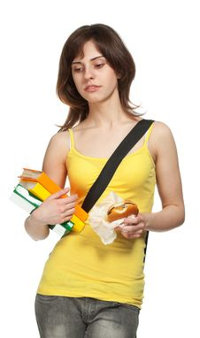 Free Sad Young Girl With Books And Hamburger Royalty Free Stock Photo - 19210455