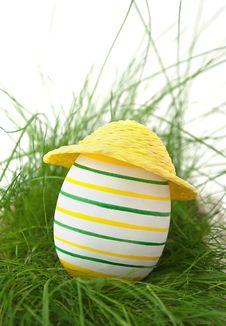 Free Easter Egg In Straw Yellow Hat In Green Grass Stock Photo - 19217680