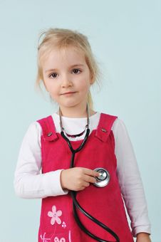 Little Girl  And Stethoscope Stock Photos