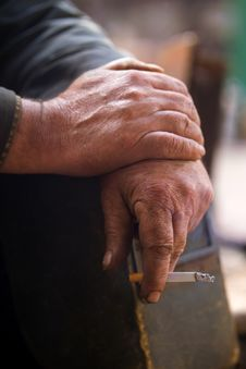 Hand Working With A Cigarette Royalty Free Stock Photo