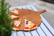 Free Pizza Sliced On The Wooden Board Royalty Free Stock Photo - 19224395