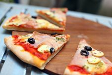 Free Sliced Pizza With Ham And Olives Stock Image - 19224401