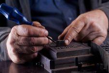 Free Men Creates A Metallic Plate Stock Image - 19224941