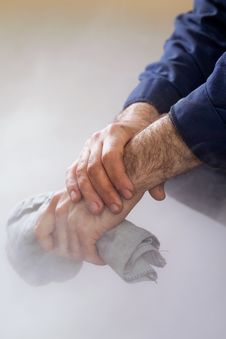 Working Hand That Holds The Cloth Royalty Free Stock Image