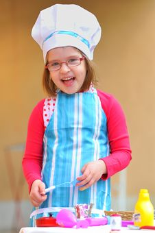 Little Girl Having Fun Playing Cooking Royalty Free Stock Photo