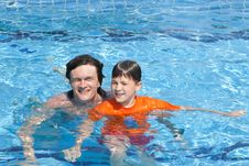 The Father And The Son In Pool Royalty Free Stock Photo
