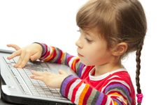 Free Little Girl With A Laptop Royalty Free Stock Image - 19229536