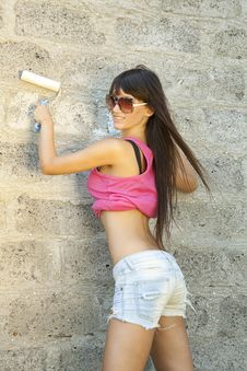 Young Woman Painting The Wall Royalty Free Stock Image