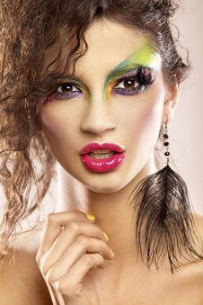 Young Attracive Female In Multicolor Make-up Royalty Free Stock Photos