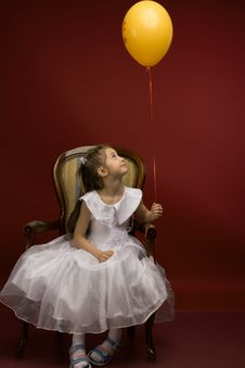 Free Little Girl With Yellow Balloon Stock Images - 19233164