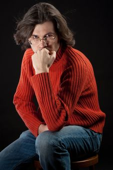 Man In Red Sweater Sitting On Chair Stock Photography