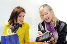 Free Girls Look At Their Purchases Royalty Free Stock Photography - 19235697