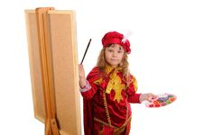 Little Girl With A Brush And Paints Royalty Free Stock Image