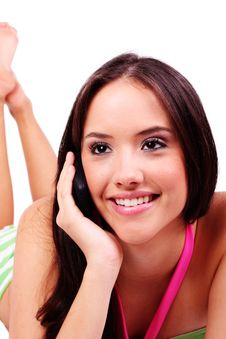 Attractive Young Woman Speaking On The Phone Stock Image
