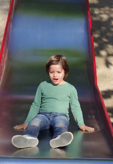 Free Boy On The Slide Royalty Free Stock Photos - 19243458