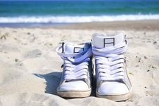 Free Sneakers On The Beach Stock Photo - 19243550