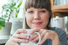 Attractive Smiling Girl With A Cup Of Tea Stock Photography