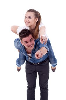 Young Man Carrying His Cute Girl On Back Royalty Free Stock Image