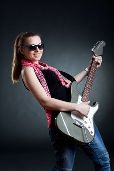 Free Girl Wearing Leather Jacket With A Guitar Stock Photo - 19244010
