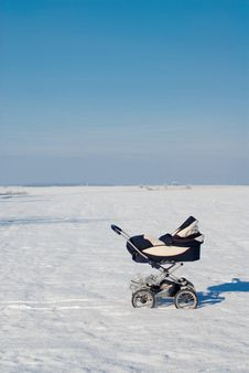 Free Baby Buggy Out In Snowy Field Stock Photos - 19249333