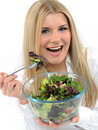Free Pretty Woman Eating Green Vegetable Salad. Stock Image - 19253481