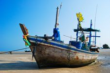 Fisherman Boat On The Sea Shore Stock Image