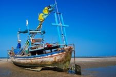 Fisherman Boat On The Sea Shore Royalty Free Stock Photos