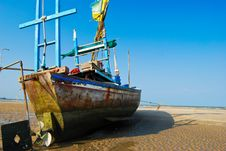 Fisherman Boat On The Sea Shore Stock Photo