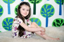 Free Little Girl With Long Hair In Colorful Dress Sits Stock Photo - 19251820