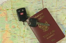 Free Passport And Car Key On Map Stock Photography - 19252132