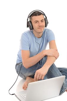 Young Man Listening To Music In Headphones Stock Images