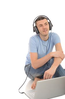 Free Young Man Listening To Music In Headphones Stock Images - 19253544