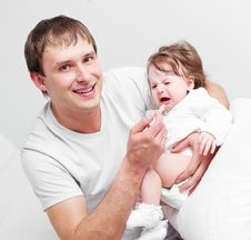 Father Feeding Daughter Stock Image
