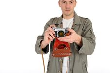 Free Professional Photographer With Film Camera Stock Image - 19254011