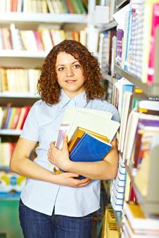 Student Standing With Books Royalty Free Stock Image