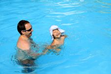 Playing A Father And Daughter At The Pool Stock Photo