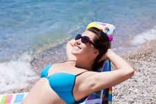 Free Young Woman Relaxing On The Beach Stock Photography - 19259932
