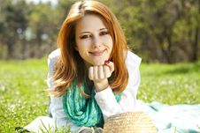 Girl At Grass In The Park. Stock Images
