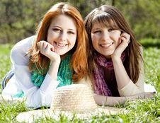 Girlfriends At Green Grass In The Park Stock Photography
