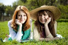 Girlfriends At Green Grass In The Park Royalty Free Stock Images