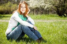 Redhead Girl With Headphone In The Park Royalty Free Stock Photography