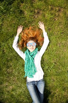 Free Girl Lies At Green Grass In The Park Royalty Free Stock Photo - 19263085