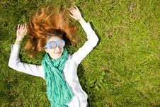Free Girl Lies At Green Grass In The Park Stock Photography - 19263092