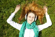 Free Redhead Girl With Headphone Lies In The Park Stock Image - 19263111
