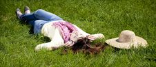 Free Brunette Girl With Headphone Lies In The Park Stock Images - 19263134