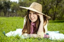 Beautiful Brunette Girl In Hat At The Park Royalty Free Stock Photo