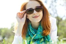 Red-haired Girl In Sunglasses At The Park. Royalty Free Stock Photos